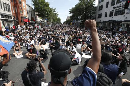 Demonstrators protest the death of George Floyd, Tuesday, June 2, 2020, in Washington. Floyd died after being restrained by Minneapolis police officers.