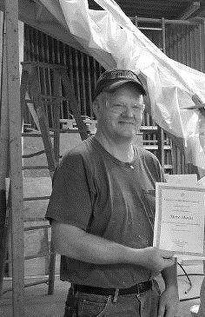 Hann receives employee award at Taney Corporation