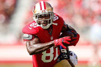 49ers wide receiver Anquan Boldin runs with the ball after a catch against the Ravens.