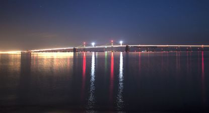 The Bay Bridge is reflected in the Chesapeake Bay on a calm night in early December.