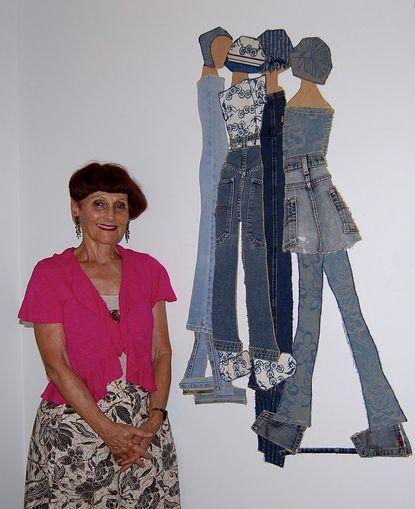 Julie van Hemert is pictured with one of her works of art.