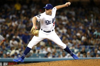 Catonsville native Adam Kolarek pitches for the Los Angeles Dodgers against Juan Soto in seventh inning of game one of the National League Division Series against the Washington Nationals at Dodger Stadium. Kolarek struck out Soto and the Dodgers won the game.