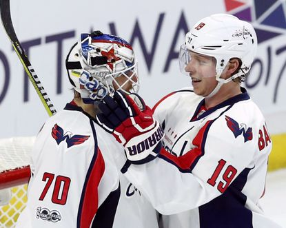 Capitals goalie Braden Holtby (70) is congratulated by teammate Nicklas Backstrom (19) after stopping 30 shots, earning him a shutout, gainst the Senators in Ottawa, Ontario, Saturday, Jan. 7, 2017.