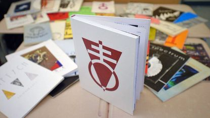 The most recent The 2016 Colophon literary magazine rests in front of past issues on May 26, 2016. The magazine's student and faculty staff has produced the Colophon since 1966.