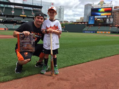 Orioles outfielder Travis Snider meets his biggest fan, 8-year-old Wyatt Anthony, who was dejected when Snider was traded from the Pittsburgh Pirates to the Orioles this past offseason. When Snider and the Orioles found out, they sent Anthony a care package and invited him to a game at Camden Yards.