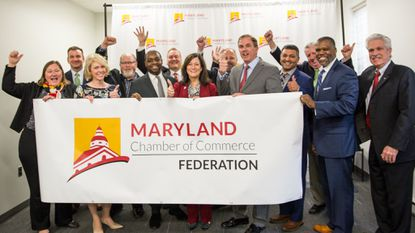 Members of the new Maryland Chamber Federation cheer behind a banner after the press conference announcing new benefits for small businesses on Jan. 23, 2019.