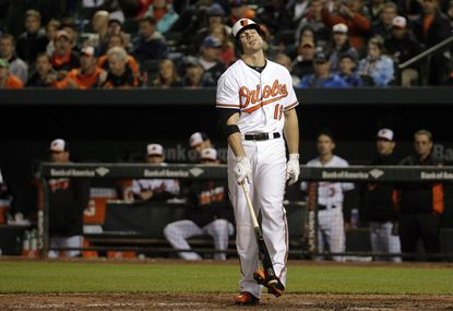 Orioles' Chris Davis reacts after striking out during a baseball game against the New York Yankees in Baltimore, Thursday, May 5, 2016.