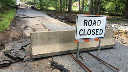 Chunks of pavement and other debris litter the landscape on and around the small bridge on Glen Cove Road over Peddler Run in Darlington after heavy rains hit the area last Friday. The road will remain closed until it can be replaced.