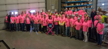 Shelter Systems' day shift employees wear pink for a company fundraiser. - Original Credit: Courtesy Photo