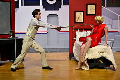 Sir Evelyn Oakley (Caleb Metcalf) is surprised in his stateroom by Reno Sweeney (Sydney Cheuvront).