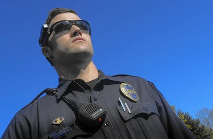 Laurel police officer Aaron Waddell wears a camera mounted on his sunglasses. Howard County will run a pilot program to test using body-mounted cameras, cameras that attach to headgear or glasses and cameras that operate through cellphones.