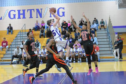 Long Reach sophomore John Shupe goes up for a lay-up in between a trio of Oakland Mills defenders during their game in early January.