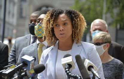 Baltimore State's Attorney Marilyn Mosby, along with Mayor Brandon Scott, left, announce that hate crime charges have been brought against a Baltimore man accused of attacking Asian-American businesses earlier this year. (Kevin Richardson/Baltimore Sun).
