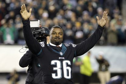 Former Philadelphia Eagles player Brian Westbrook takes the field prior to an NFL football game between the New York Giants and the Philadelphia Eagles Monday, Oct. 19, 2015, in Philadelphia.