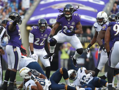 Ravens' #23 Kendrick Lewis jumps in the air after he tackles Chargers' quarterback #17 Philip Rivers for a lose in the fourth quarter.