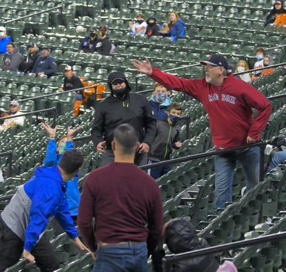 Fans watch afoul ball hit by Baltimore Orioles batter Pat Valaika during the second inning at Oriole Park at Camden Yards Fri., May 7, 2021. (Karl Merton Ferron/Baltimore Sun Staff)