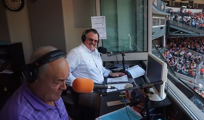 Fred Manfra, right, enjoys a laugh with longtime radio partner Joe Angel during Manfra's final Orioles broadcast Sunday, June 4, 2017, at Camden Yards.