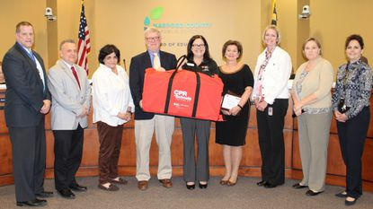 Harford County Public Schools leaders are joined by representatives of the American Heart Association and LifeBridge Health Monday night, as the school system and its staff and students were recognized for raising more than $476,000 for the Heart Association last school year.