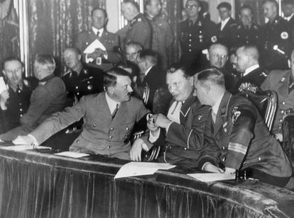 When Chancellor Adolf Hitler called a private meeting of German Nazis for Jan. 3, 1935 and excluded even Nazi newspapermen, rumors were rife that an upheaval in the Nazi party was under way. This exclusive photograph, taken inside the Berlin State Opera House, shows the opera party that followed the meeting. (AP Photo)
