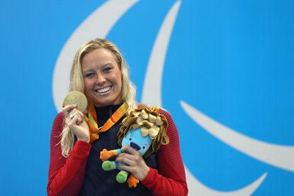 Jessica Long ofBaltimorecelebrates on the podium at the medal ceremony with a gold for winning thewomen's 200-meterindividual medley - SM8 on Saturday.