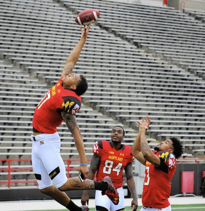 College Park,MD-8/10/15 --University of Maryland football players L-R #17 Josh woods, #84 Amba Etta-Tawo and #13 DeAndre Lane. University of Maryland football media day at Capital One Field at Byrd Stadium. Lloyd Fox/Baltimore Sun #4250