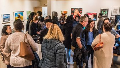 Area art fans fill the Montpelier Art Center gallery and wait for the announcement of the winners in the artists on the rise competition.