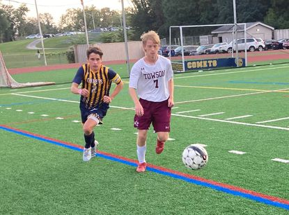 Towson's Zachary Sales, right, dribbles as Catonsville's Nick Sirasky follows in the Generals' 3-2 victory on Wednesday.