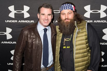 Kevin Plank and Willie Robertson attend Under Armour's opening of the largest brand house on Chicago's Magnificent Mile.