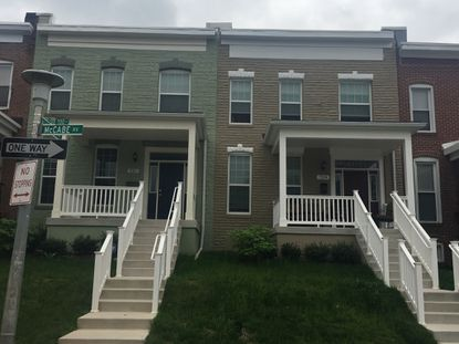 In neighborhoods like North Baltimore's Woodbourne-McCabe, Habitat for Humanity of the Chesapeake is restoring vacant homes and parking lots into affordable housing units.