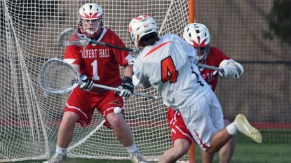 Calvert Hall goalie Liam Darragh, left, gets ready to block a shot by McDonogh's Matt Hilgartner in the second quarter of boys lacrosse game last April. File.