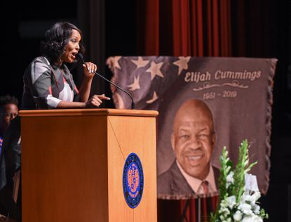 Dr. Maya Rockeymoore Cummings gives remarks during a ceremony celebrating the life of her husband, Elijah Cummings, at Morgan State University on October 23.