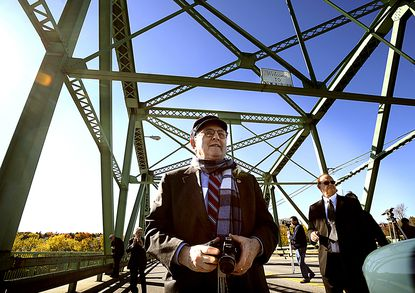 Dr. Bernard Lown walks on the bridge renamed in his honor Friday, Oct. 17, 2008, in Lewiston, Maine. Lown, a Massachusetts cardiologist who invented the first reliable heart defibrillator and later co-founded an anti-nuclear war group that was awarded a Nobel Peace Prize, died Tuesday, Feb. 16, 2021. He was 99. (The Lewiston Sun-Journal)