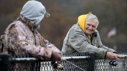 Calvin Young, left, of Upper Fells Point gives some tips to Mike Jaremko of Butchers Hill while they cast for freshwater panfish called crappie off the bridge spanning Loch Raven Reservoir on Dulaney Valley Road on Nov. 12.