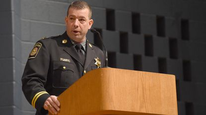 Sheriff Jim DeWees addresses the graduates during the Carroll County Sheriff's Office Training Academy graduation ceremony held at Winters Mill High School on Friday, March 22.