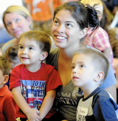 Aiden, Maria, and Austin Quarles, of Westminster, look on during Storytime with the Zoo, a visit from the Maryland Zoo ZOOmobile at the Finksburg Branch of the Carroll County Public Library on Sept. 17, 2015. The ZOOmobile will be at the Westminster branch on Friday, Sept. 30.