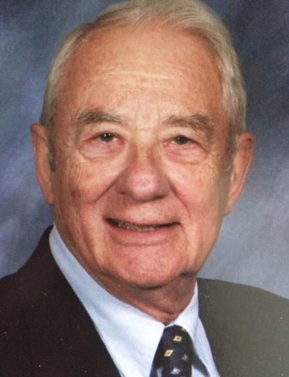 August Martin Wildberger, a retired Navy commander who specialized in computer education, died May 26.