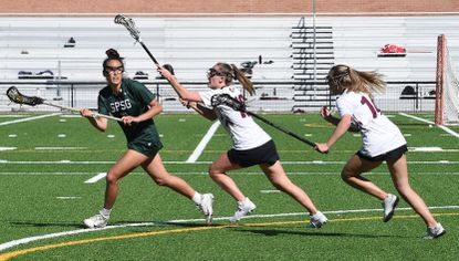 St. Paul's #7, Megan Hiller, looks to pass the ball in the 1st half. St. Paul's Girls School vs Severn School Girls Lacrosse Monday April 26, 2021 at Severn School. St.Paul's defeated Severn 11-6.