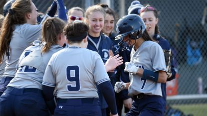 Megan Hughes (7), seen being congratulated by teammates as she touches the plate after hitting a solo home run during a softball game against Howard last season, is among the top returners this spring for a Marriotts Ridge team trying to repeat as Howard County champions.