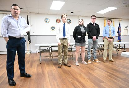 Adrian Gamboa, left, post commander of Carroll Post No. 31, announces the results of their local American Legion High School Oratorical Scholarship Program competition on Jan. 16. The four competitors, all from Winters Mill High School, include, from left, Eli Hansbrough, Samantha Coale, Nathan Martin and Nick Henderson.