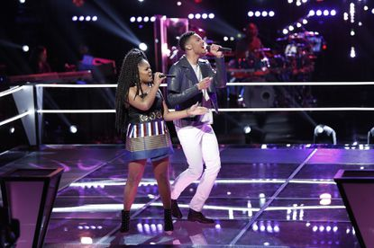"Ayanna Jahnee and Randallstown native Joe Maye sing in the ""battle rounds"" during the NBC show ""The Voice."""