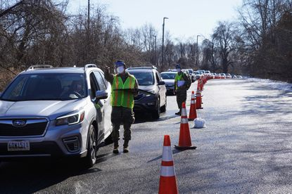 Cars lined up at a mass vaccine site that opened for Maryland residents in the parking lot of Six Flags on February 5, 2021 in Upper Marlboro. The Pfizer vaccine was made available to people who qualified for one of the 10,000 appointment slots made available. According to Governor Larry Hogan, who has been criticized for the state's botched and confusing vaccine rollout, the appointments were all booked within 20 minutes. (Photo by Michael Robinson Chavez/The Washington Post) - Original Credit: The Washington Post
