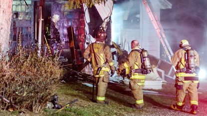 Fire crews work at the scene of a house fire in the 3800 block of Niner Road in Gamber Tuesday Nov. 28, 2017. No one was injured in the blaze that was reported around 5:52 p.m.