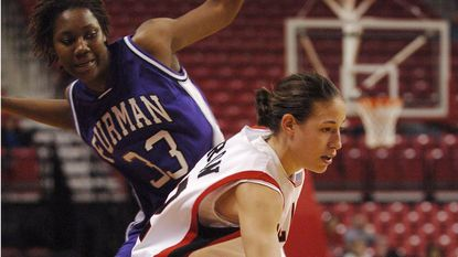 Guard Shay Doron eludes Furman's Courtney Opie during Maryland's 92-58 win in the final of the Terrapin Classic at Comcast Center.
