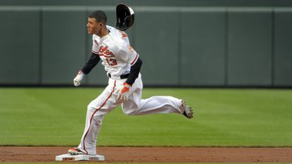 Orioles third baseman Manny Machado (13) rounds second on his way to a triple during the first inning of the second game of a doubleheader at Camden Yards. Machado later scored, and Baltimore split the the doubleheader winning the second game, 6-3.