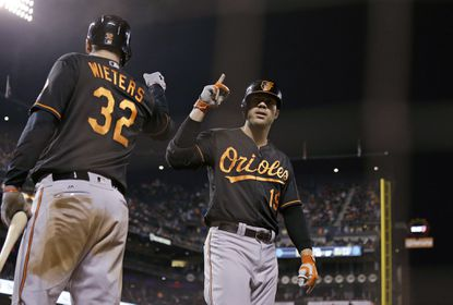 Baltimore Orioles' Chris Davis, right, is greeted by Matt Wieters after hitting a home run off San Francisco Giants starting pitcher Matt Cain during the fifth inning of a baseball game Friday, Aug. 12, 2016, in San Francisco.