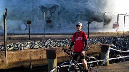 Towson High 2010 graduate Kyle King, of Wiltondale, is pictured with the bike he will ride cross-country to raise money for the Ulman Cancer Fund. King, one of 35 local riders comprising Team Seattle, leaves Baltimore's Inner Harbor on June 1 and is scheduled to reach Seattle, Wash. on Aug. 9.