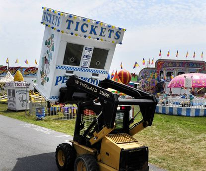A worker moves the final ticket booth into place on the carnival grounds Tuesday afternoon at the Harford County Equestrain Center in preparation for the carnival's kick-off Tuesday evening. The event is being held this week as a fund-raiser for the traditional Harford County Farm Fair July 26-27.