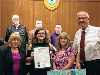 """Autumn Liked, front row second from left, is honored by the Bel Air town commissioners Tuesday as a """"model student and citizen of our town and county."""""""