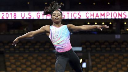 Simone Biles practices on the floor during a training session at the U.S. Gymnastics Championships, Wednesday, Aug. 15, 2018, in Boston.