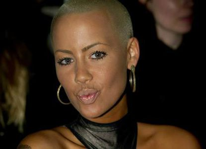 """Amber Rose, Wiz's girlfriend. If """"Top Floor"""" is for her, he should apologize for its lameness."""